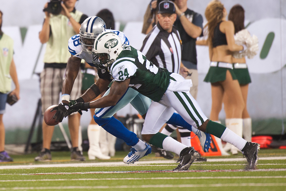 EAST RUTHERFORD, NJ - SEPTEMBER 11: Darrelle Revis #24 of the New York Jets fights for the ball against the Dallas Cowboys at MetLife Stadium on September 11, 2011 in East Rutherford, New Jersey. The Jets defeated the Cowboys 27 to 24. (Photo by Rob Tringali) *** Local Caption ***
