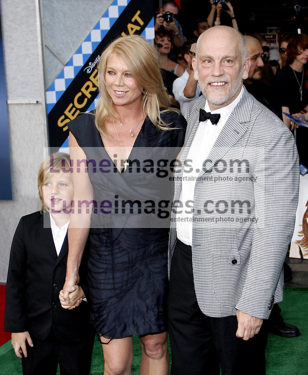 HOLLYWOOD, CA - SEPTEMBER 30, 2010: John Malkovich and Peta Wilson at the Los Angeles premiere of 'Secretariat' held at the El Capitan Theater in Hollywood, USA on September 30, 2010.