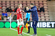 Middlesbrough Head Coach Jonathan Woodgate speaks with Middlesbrough midfielder George Saville (22) during the EFL Sky Bet Championship match between Middlesbrough and Charlton Athletic at the Riverside Stadium, Middlesbrough, England on 7 December 2019.