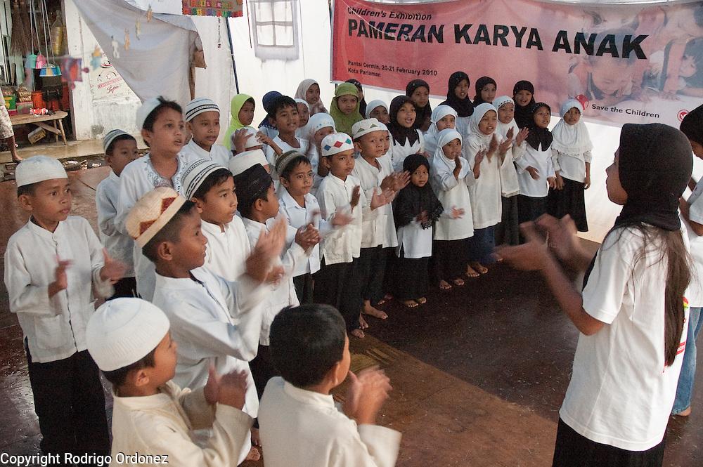 Children sing at a child-friendly space in Koto Kaciak, West Sumatra, Indonesia.