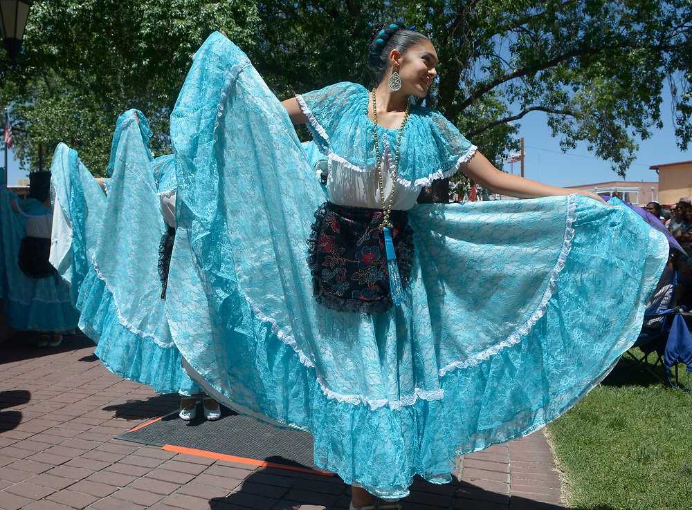 gbs060417h/ASEC -- Cecilia Munoz of Albuquerque, a member of Baila Baila dance troupe performs in Old Town Plaza during the San Felipe de Neri Fiesta on Sunday, June 4, 2017. (Greg Sorber/Albuquerque Journal)