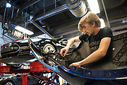 Brandon Christie of Sonora re-assembles a Tesla Model 3 bumper during the Tesla Start class at Evergreen Valley Community College in San Jose, California, on August 8, 2019. (Stan Olszewski for Silicon Valley Business Journal)