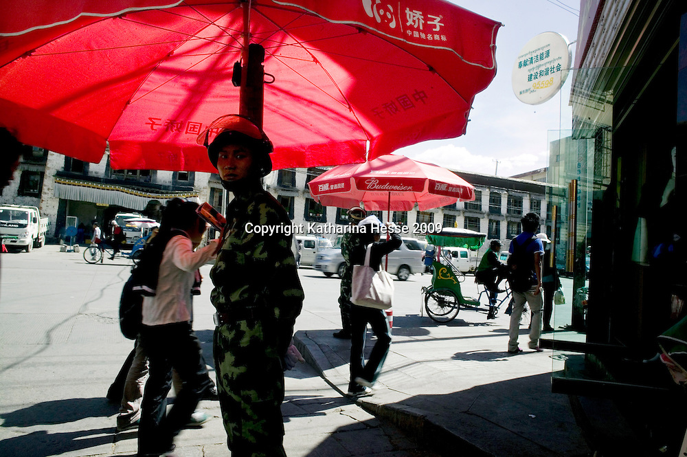 LHASA, JUNE-16, 2009 : a Chinese soldier guards the entrance to the Tibetan district in Lhasa.