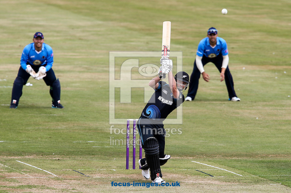 Colin Munro of New Zealand A (centre) hits the ball to the boundary for four during the Tour Match match at the County Ground, Northampton, Northampton<br /> Picture by Andy Kearns/Focus Images Ltd 0781 864 4264<br /> 31/07/2014