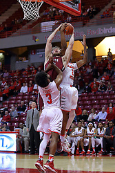 26 November 2016:  Evan Hall reaches for a rebound which is also sought by Keyshawn Evans(3) and DJ Clayton(2) during an NCAA  mens basketball game between the IUPUI Jaguars the Illinois State Redbirds in a non-conference game at Redbird Arena, Normal IL