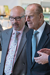 © Licensed to London News Pictures . FILE PICTURE DATED 14/11/2013 . Manchester , UK . LEN WARDLE (left in glasses) with the Prince Philip the Duke of Edinburgh at the Co-operative's new corporate HQ at 1 Angel Square . The chairman of the Co-operative Group , Len Wardle , has resigned after a sex and drugs scandal involving the group's former banking chairman , Paul Flowers . Queen Elizabeth II and the Duke of Edinburgh visit the Coop building at 1 Angel Square , Manchester , this morning ( 14th November 2013 ) . Photo credit : Joel Goodman/LNP