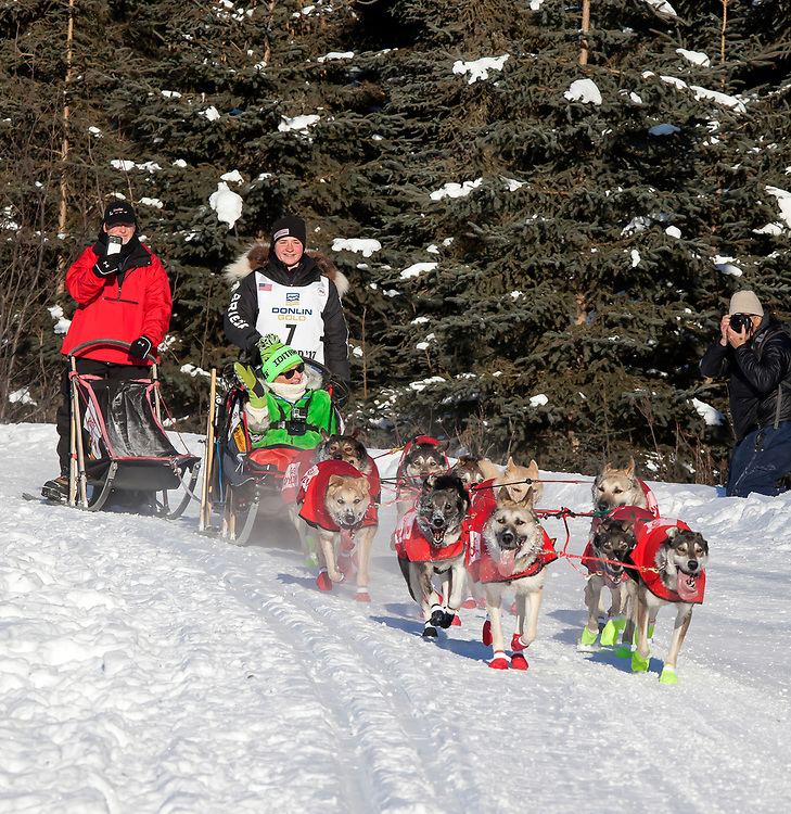 Alaska. Musher Laura Neese of Michigan and team running through trails of Anchorage during the 2017 Iditarod Ceremonial start, Anchorage.