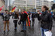"""About 40 right-wing activists of islamophobic """"Freie Buerger fuer Frankfurt"""" (formerly PEGIDA) are rallying in the german city of Frankfurt am Main, activist and organiser Ester Seitz (with microphone) is holding a speech."""
