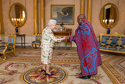 Queen Elizabeth II meets the High Commissioner of Lesotho Dr. John Oliphant as he presents his Letters of Credence during an audience at Buckingham Palace, London.