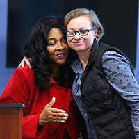 Adam Robison | BUY AT PHOTOS.DJOURNAL.COM<br /> Elaine Bowers, of Tupelo, hugs lifegaurd Sihya Smith at the Tupelo Aquatic Center Monday morning. Smith received the American Red Cross Lifesaving Award Monday for saving Bower's life during swimming lessons last spring.