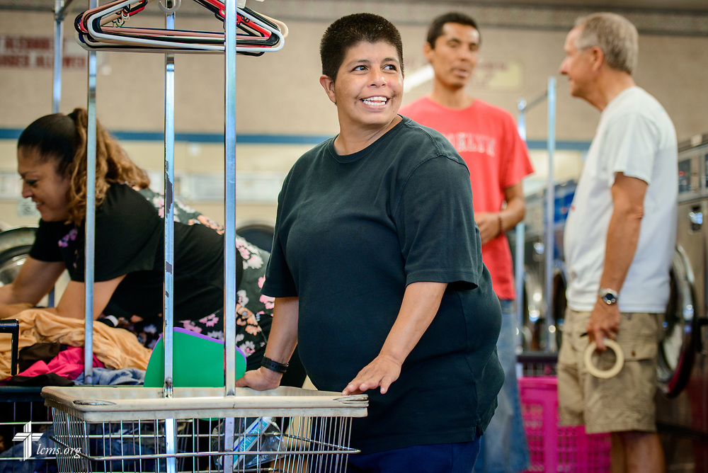 "Helen Borrego smiles during the Laundry Love event on Wednesday, Aug. 2, 2017, at the E-Z Wash laundromat in San Antonio. The monthly ministry event is supported by a grant through the ""Stand With Your Community"" program, which was made possible by a partnership between the LCMS, Thrivent Financial and Lutheran Church Extension Fund. LCMS Communications/Erik M. Lunsford"