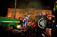 Farmers drive their tractors during a protest in front of the Greek parliament  in Athens February 12, 2016. <br /> Farmers from across Greece gather in Athens for a two-day protest against the government and its plans to impose new tax hikes and pension charges.