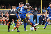 Bayo Akinfenwa forward for AFC Wimbledon (10) in action during the Sky Bet League 2 match between AFC Wimbledon and Newport County at the Cherry Red Records Stadium, Kingston, England on 7 May 2016. Photo by Stuart Butcher.