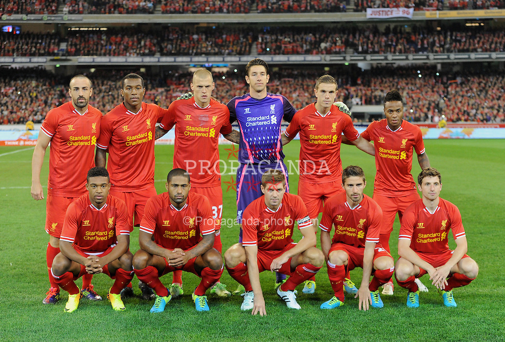 MELBOURNE, AUSTRALIA - Wednesday, July 24, 2013: Liverpool players line up for a team group photograph before a preseason friendly match against Melbourne Victory at the Melbourne Cricket Ground. Back row L-R: Jose Enrique, Andre Wisdom, Martin Skrtel, goalkeeper Brad Jones, Jordan Henderson, Raheem Sterling. Front row L-R: Jordon Ibe, Glen Johnson, captain Steven Gerrard, Fabio Borini, Joe Allen. (Pic by David Rawcliffe/Propaganda)