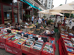 Secondhand books for sale at bohemian cafe and bookshop Tasso on Karl Marx Allee in former East Berlin in Germany