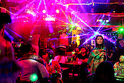 Tourists fill a nightclub in old-town Lijiang,Yunnan, China; September, 2013. Karaoke acts move from club to club along Xinhua Jie and Jiuba Jie (Bar street).