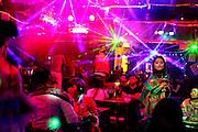 Tourists fill a nightclub in old-town Lijiang,Yunnan, China; September, 2013. Karaoke acts move from club to club along Xinhua Jie and Jiuba Jie (Bar street).