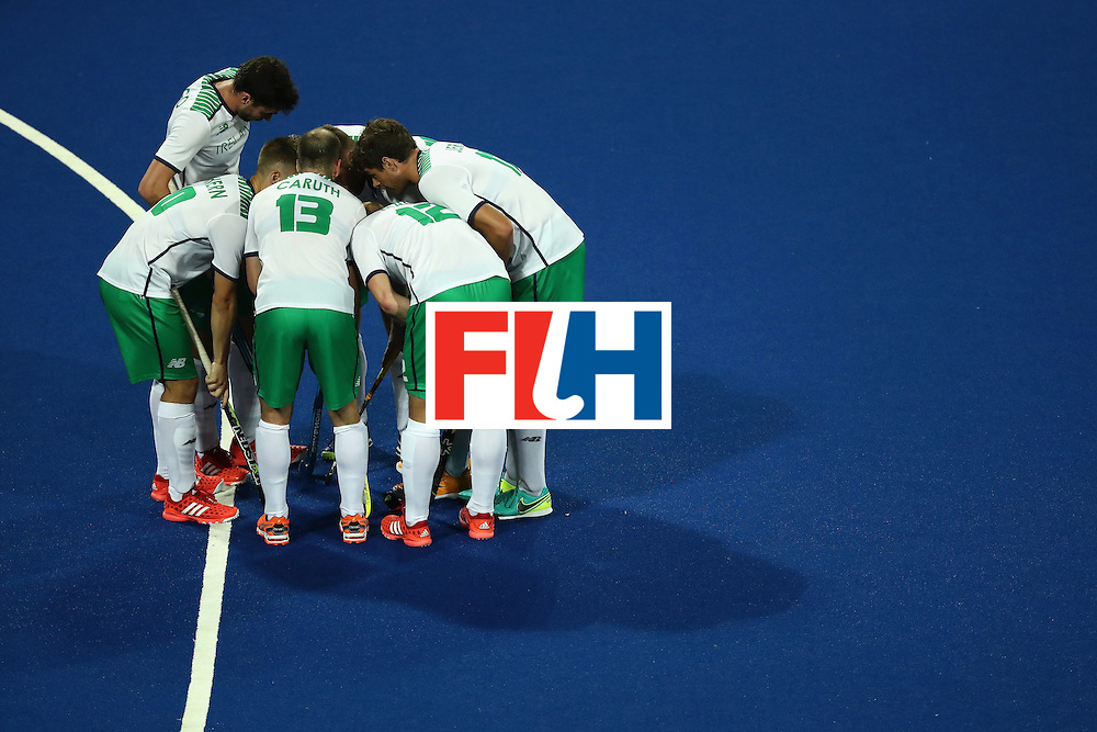 RIO DE JANEIRO, BRAZIL - AUGUST 12:  Team Ireland huddles against Argentina during a Men's Preliminary Pool A match on Day 7 of the Rio 2016 Olympic Games at the Olympic Hockey Centre on August 12, 2016 in Rio de Janeiro, Brazil.  (Photo by Sean M. Haffey/Getty Images)