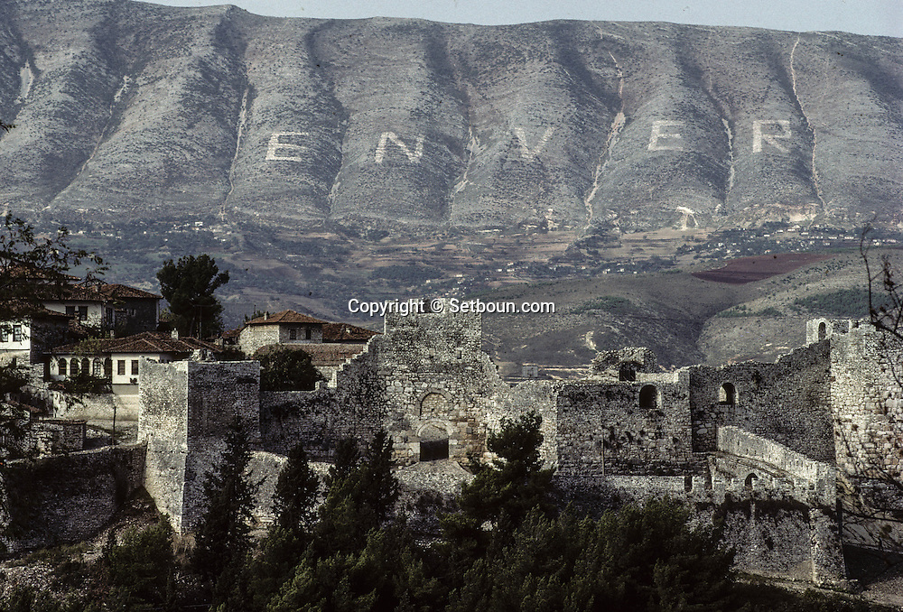 Albania under the communist regime.  Fortifications of BERAT, in the distance on the mountain a huge  ENVER (for Enver Hoxha, the famous Albanian leader).    Albania   /