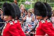 Guardsmen march past an excited fan - Queens 90th birthday was celebrated by the traditional Trooping the Colour as well as a flotilla on the river Thames.