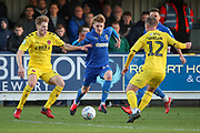 AFC Wimbledon Jack Rudoni (12) dribbling and battles for possession with Fleetwood Town midfielder Glenn Whelan (12) during the EFL Sky Bet League 1 match between AFC Wimbledon and Fleetwood Town at the Cherry Red Records Stadium, Kingston, England on 8 February 2020.