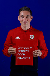 CARDIFF, WALES - Tuesday, October 9, 2018: Wales' Harry Wilson holds a Dangos y Cerdyn Coch I Hiliaeth (Show Racism The Red Card) sign during a media session at the St Fagans National Museum of History ahead of the International Friendly match between Wales and Spain. (Pic by David Rawcliffe/Propaganda)