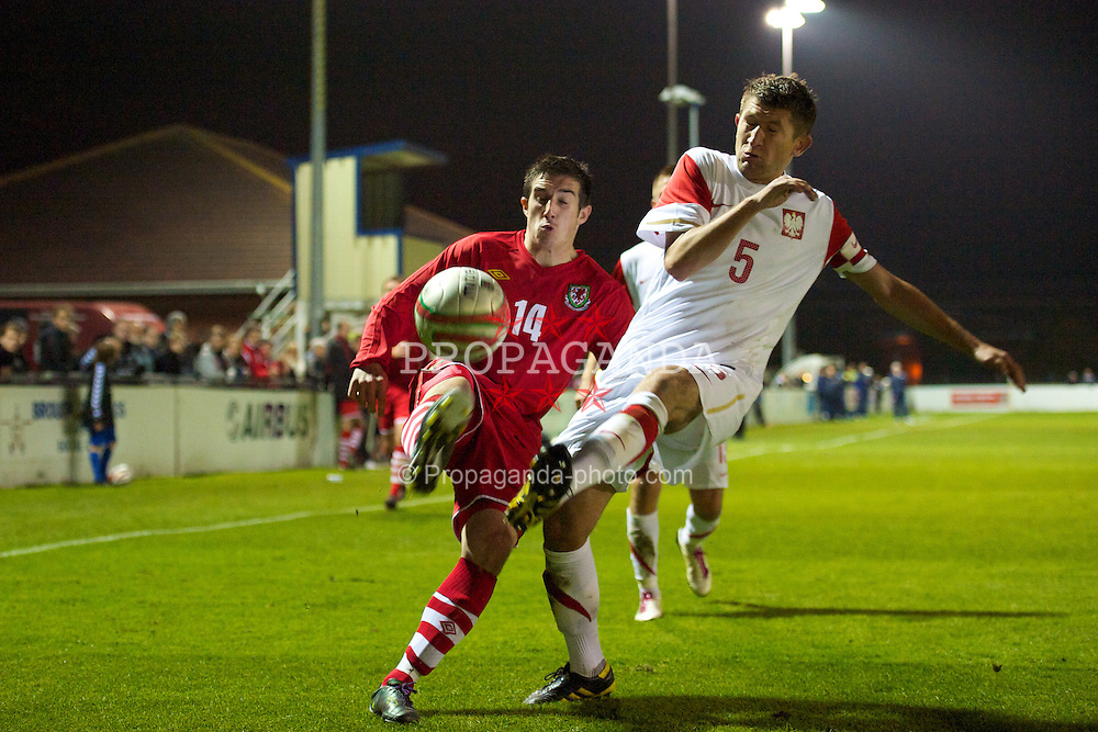 BROUGHTON, WALES - Wednesday, October 13, 2010: Wales' Craig Jones (The New Saints) and Poland's Przemyslaw Kocot during the Under-23 Semi-Pro International International Challenge Trophy match at the Airfield. (Pic by David Rawcliffe/Propaganda)
