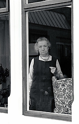 Elderly woman looking out of the window in private residential care home, Nottingham UK 1986