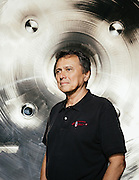 CEO of Ad Astra Rocket Company Dr. Franklin Chang-Diaz is photographed in front of Ad Astra's vacuum chamber Thursday afternoon March 19, 2015 where they test their Variable Specific Impulse Magnetoplasma Rocket (VASIMR®) technology.<br /> <br /> Photographed by editorial and commercial Houston photographer Nathan Lindstrom<br /> <br /> Nathan Lindstrom Photography<br /> ©2015 Nathan Lindstrom