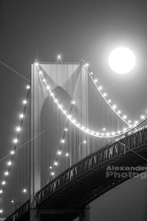 Full moon rises over the Newport Pell Bridge. Seen from the Jamestown side.
