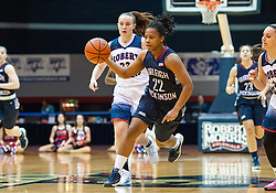 March 6 2016: Fairleigh Dickinson Lady Knights guard Kiana Brown (22) brings the ball up court during the first half in the NCAA Women's Basketball game between the Fairleigh Dickinson Lady Knights and the Robert Morris Colonials at the Charles L. Sewall Center in Moon Township, Pennsylvania (Photo by Justin Berl)