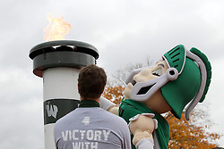 18 October 2014:  Tommy titan lights the victory torch during an NCAA division 3 football game between the Augustana Vikings and the Illinois Wesleyan Titans in Tucci Stadium on Wilder Field, Bloomington IL