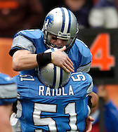 MORNING JOURNAL/DAVID RICHARD.Jeff Garcia is congratulated by center Dominic Raiola after Garcia scrambled one yard for a touchdown on fourth down yesterday in the second quarter.