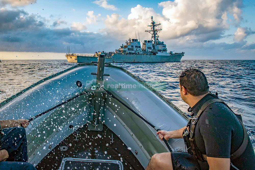 180928-N-UY653-088<br /> MEDITERRANEAN SEA (Sept. 28, 2018) Operations Specialist 2nd Class Emmanuel Garcia maneuvers a rigid-hull inflatable boat alongside the Arleigh Burke-class guided-missile destroyer USS Carney (DDG 64) as the ship participates in a smart defense exercise (SMARTEX) led by Spain, Sept. 28, 2018. SMARTEX is a NATO initiative designed to enhance interoperability and training between participating countries. Carney, forward-deployed to Rota, Spain, is on its fifth patrol in the U.S. 6th Fleet area of operations in support of regional allies and partners as well as U.S. national security interests in Europe and Africa. (U.S. Navy photo by Mass Communication Specialist 1st Class Ryan U. Kledzik/Released)