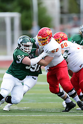 19 September 2015:  Kyle Venhuizen works on Corey Meyer during an NCAA division 3 football game between the Simpson College Storm and the Illinois Wesleyan Titans in Tucci Stadium on Wilder Field, Bloomington IL