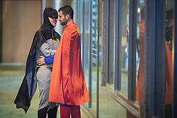 © Licensed to London News Pictures . 29/10/2016 . Manchester , UK . Two men , one wearing a Batman costume and the other a Superman costume , engage in an intimate embrace and kiss . Revellers on a night out , many in fancy dress , on the weekend before Halloween . Photo credit : Joel Goodman/LNP