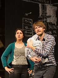 "© Licensed to London News Pictures. 24/09/2014. London, England. Pictured: Eva Meckbach as Mrs Stockmann and Christoph Gawenda as Dr Stockmann. German theatre company Schaubühne Berlin present an adaptation of ""An Enemy of the People"" by Henrik Ibsen at the Barbican Theatre, Barbican Centre, from 24-28 September 2014. The play is directed by Thomas Ostermeier and part of the International Ibsen Season. Photo credit: Bettina Strenske/LNP"