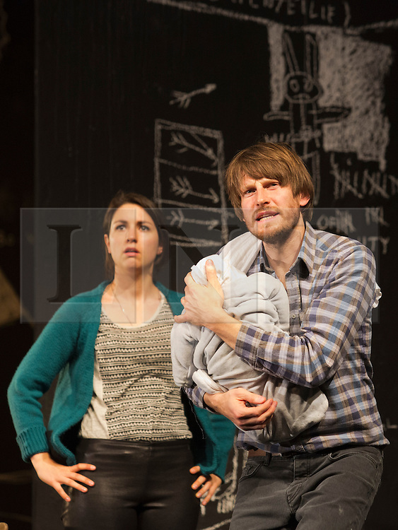 """© Licensed to London News Pictures. 24/09/2014. London, England. Pictured: Eva Meckbach as Mrs Stockmann and Christoph Gawenda as Dr Stockmann. German theatre company Schaubühne Berlin present an adaptation of """"An Enemy of the People"""" by Henrik Ibsen at the Barbican Theatre, Barbican Centre, from 24-28 September 2014. The play is directed by Thomas Ostermeier and part of the International Ibsen Season. Photo credit: Bettina Strenske/LNP"""