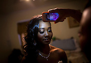Rahimah Gaither uses a cell phone flashlight to check Nailah Bradley's makeup as she prepares for prom Saturday, May 17, 2014. (Brian Cassella/Chicago Tribune) B583716572Z.1  ....OUTSIDE TRIBUNE CO.- NO MAGS,  NO SALES, NO INTERNET, NO TV, CHICAGO OUT, NO DIGITAL MANIPULATION...