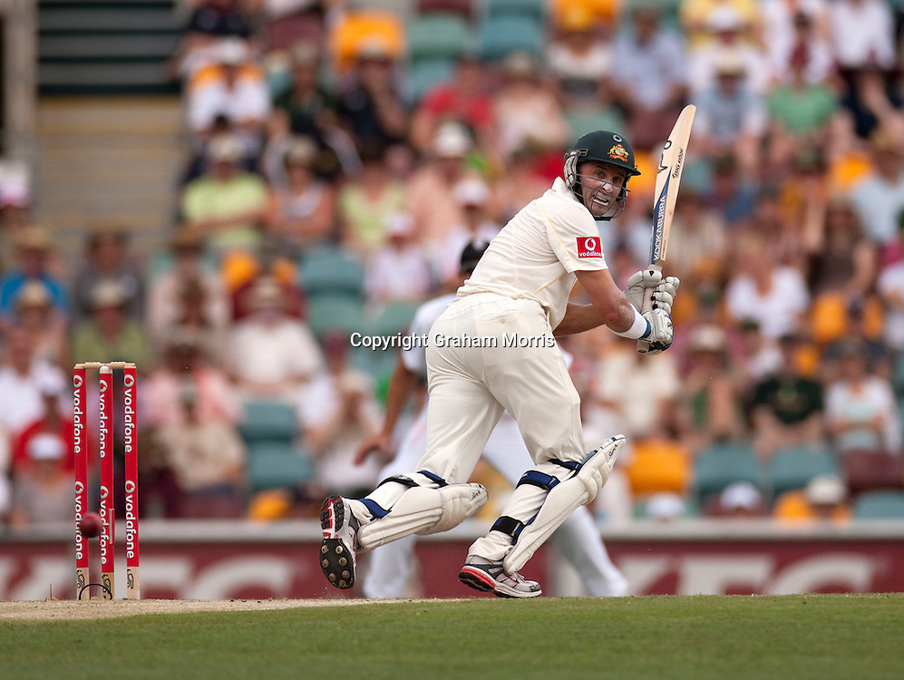 Michael Hussey bats during his 195 in the first Ashes Test Match between Australia and England at the Gabba, Brisbane. Photo: Graham Morris (Tel: +44(0)20 8969 4192 Email: sales@cricketpix.com) 27/11/10