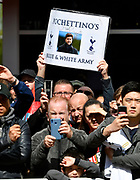 A banner with Tottenham Hotspur manager Mauricio Pochettino Blue & White Army on it being held up as players arrive during the Premier League match between Bournemouth and Tottenham Hotspur at the Vitality Stadium, Bournemouth, England on 4 May 2019.