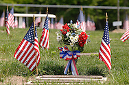 Goshen, N.Y. - Flags and flowers decorate the graves at Orange County Veterans Cemetery for Memorial Day on May 29, 2006. ©Tom Bushey
