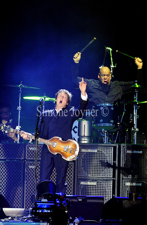 Sir Paul McCartney performs live on the main stage during day three of the Isle of Wight Festival 2010 at Seaclose Park on June 13, 2010 in Newport, Isle of Wight.(Photo by Simone Joyner)