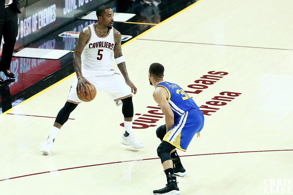 07 June 2017: Golden State Warriors guard Stephen Curry (30) defends on Cleveland Cavaliers guard JR Smith (5) during the Golden State Warriors 118-113 victory over the Cleveland Cavaliers, in game 3 of the 2017 NBA Finals, at  the Quicken Loans Arena, Cleveland, Ohio, USA.