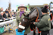 Proud Owner JAYNE SIVILLS gives a well earned drink to her horse LADY BUTTONS ridden by Adam Nicol and trained by Phil Kirby after winning The Listed (Class 1) OLBG.com Mares Hurdle Race (NHMOPS Bonus Race) over 2m (£22,000)  during the Bet365 Meeting at Wetherby Racecourse, Wetherby, United Kingdom on 3 November 2018. Picture by Mick Atkins.