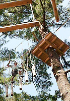Jim Bobotas of Gilford makes his way through the final black course at Gunstock Mountain Resort's Treetop Adventure over the July 4th weekend.  (Karen Bobotas/for the Laconia Daily Sun)