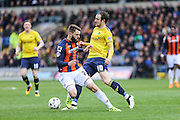 Oxford United's goalscorer Danny Hylton and Luton Town's Josh McQuoid battle for the ball during the Sky Bet League 2 match between Oxford United and Luton Town at the Kassam Stadium, Oxford, England on 16 April 2016. Photo by Shane Healey.