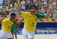 Football-FIFA Beach Soccer World Cup 2006 - Semi-final -BRA_POR -Betinho, followed by Benjamin-BRA- runs to celebrate his goal - Rio de Janeiro - Brazil 11/11/2006<br />Mandatory credit: FIFA/ Marco Antonio Rezende.