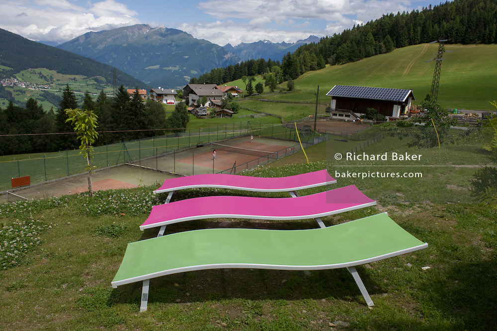 Vacant sun loungers at a health spa on the Jaufenpass, Dolomites, South Tyrol, Italy.
