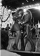 Tina Turner Live At The RDS.  (R59)..1987..30.05.1987..05.30.1987..30th May 1987..As part of her world tour Tina Turner took to the stage at the RDS,Dublin. Accompanied by her band, singers and dancers she played to a sell out audience, thrilling them with her renditions of her classic hits...Image shows Tina really into the rock and roll with assistance from her guitarist on stage at the RDS.